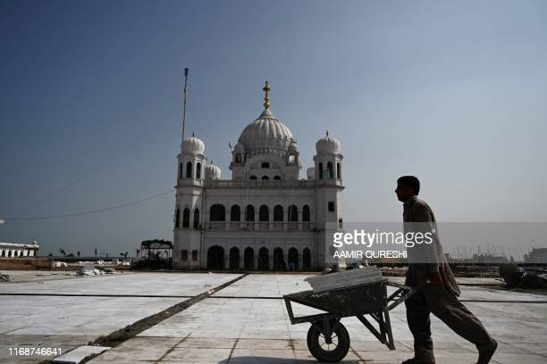 TOPSHOT In this picture taken on September 16 2019 a man works on the construction site at the Sikh religious site Gurdwara Darbar Sahib in the...