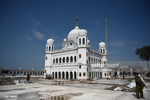 In this picture taken on September 16 2019 a Pakistani policeman stands guard on the construction site at the Sikh religious site Gurdwara Darbar...