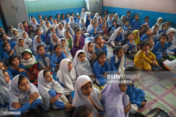 In this picture taken on September 18 girls attend a class in a school in Mingora a town in Swat Valley Pakistan sits on a demographic time bomb...
