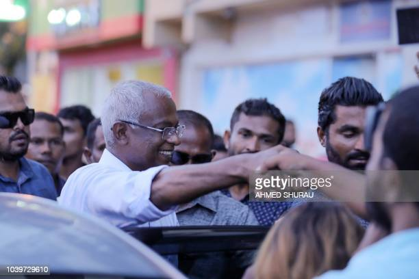 In this picture taken on September 24 2018 Ibrahim Mohamed Solih greets a crowd after winning Maldives' presidential election in Male Maldives...