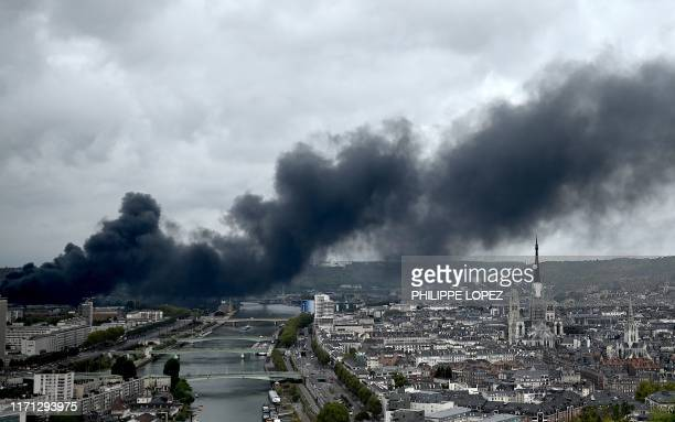 In this picture taken on September 26 2019 in Bonsecours smoke billows from a Seveso classified Lubrizol factory on fire in Rouen northwestern France...