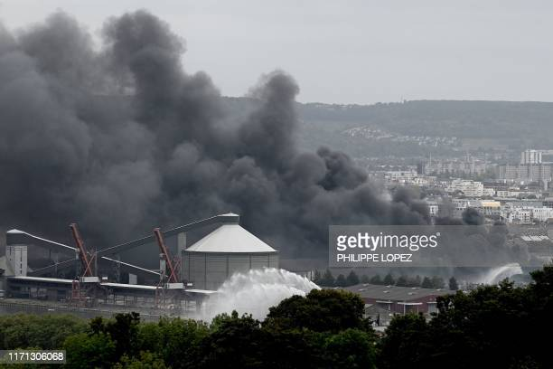 In this picture taken on September 26 2019 in Rouen smoke billows from a Seveso classified Lubrizol factory on fire Residents of twelve towns...