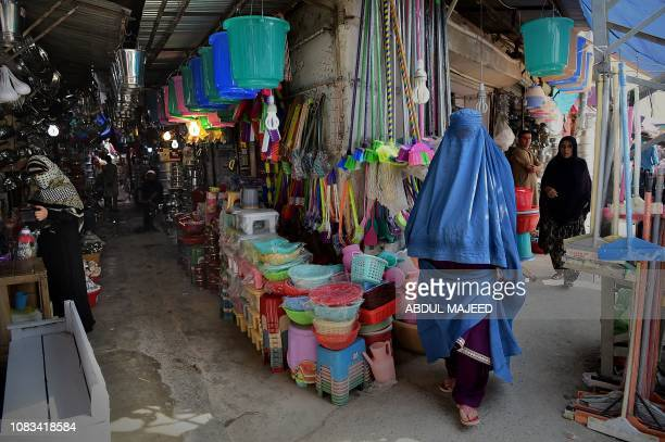 In this picture taken on September 29 2018 an Afghan refugee woman walks in the historic Qissa Khawani bazaar in Peshawar Pakistan is one of the...