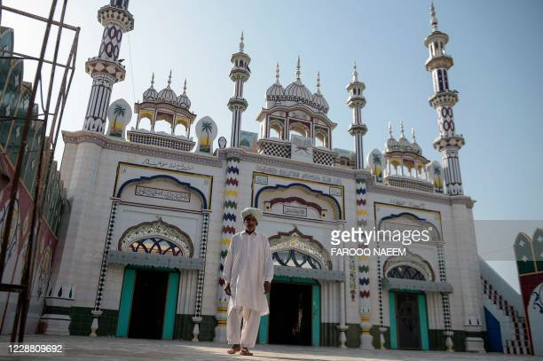 In this picture taken on September 29 2020 a man walks out from the mosque where Hassan Arshad an 18yearold Pakistani born who injured two people in...