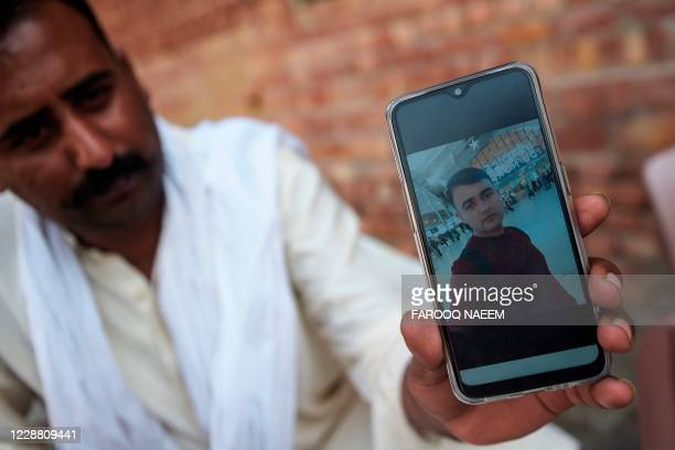In this picture taken on September 29 a relative of Hassan Arshad an 18yearold Pakistani born who injured two people in a meat cleaver attack in...