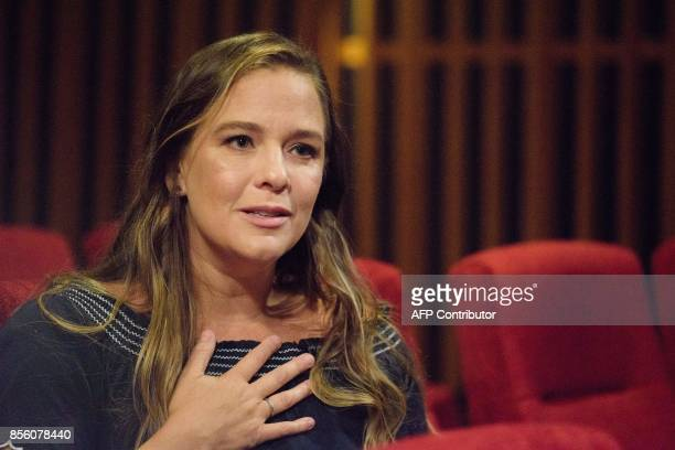 In this picture taken on September 5 Joanna Bowers Hong Kongbased writer and director of new documentary The Helper gestures during an interview with...