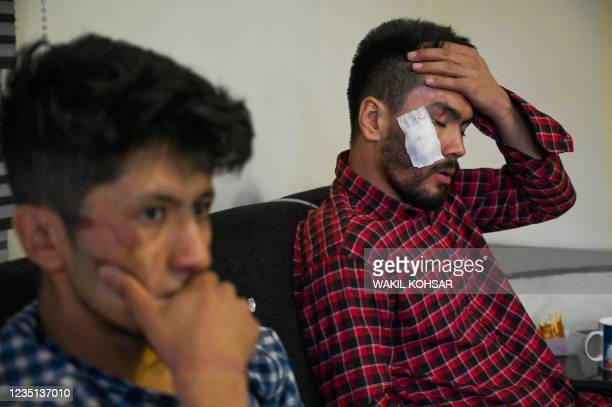 In this picture taken on September 8 Afghan newspaper Etilaat Roz journalists Nematullah Naqdi and Taqi Daryabi sit in their office after being...