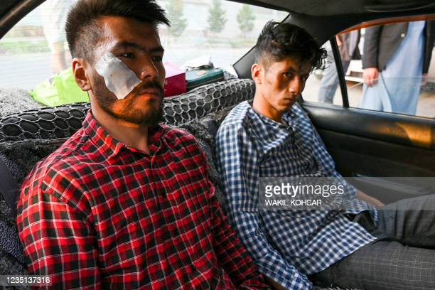 In this picture taken on September 8 Afghan newspaper Etilaat Roz journalists Nematullah Naqdi and Taqi Daryabi arrive at their office after being...