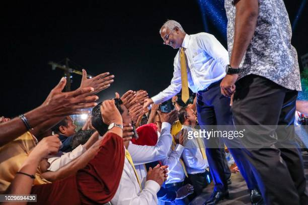In this picture taken on September 8 Maldives' main opposition leader and presidential candidate Ibrahim Mohamed Solih greets a crowd during a...