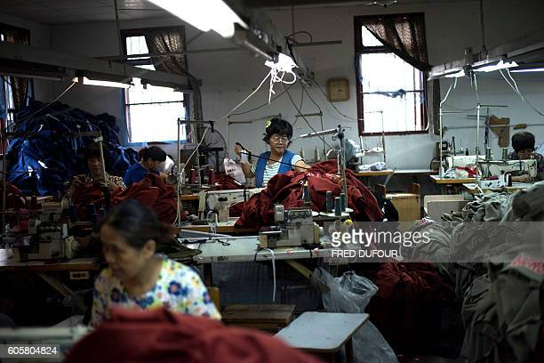 In this picture taken on September 8 workers prepare sew tshirts in a factory in Zhujiajiao on the outskirts of Shanghai China's industrial output...