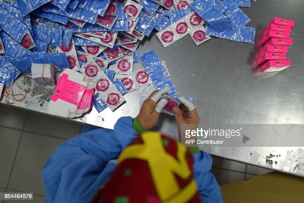 In this picture taken September 20 a worker packs condoms at the Malaysian condommaker Karex Industries headquarters in Port Klang After enjoying...