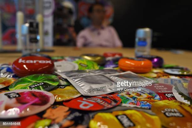 In this picture taken September 20 packs of 'nasi lemak' flavoured condoms are seen amidst others at the Malaysian condommaker Karex Industries...