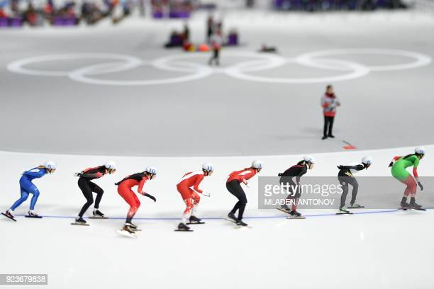 TOPSHOT In this picture taken with a tilt and shift lens athletes compete in the women's mass start semifinal speed skating event during the...