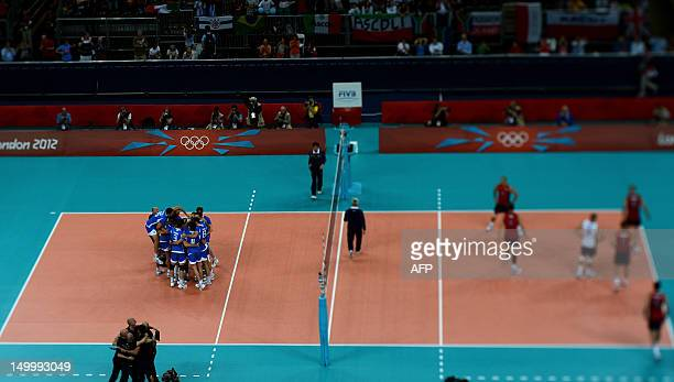 In this picture taken with a Tilt and Shift lens, Italy celebrates after defeating the US during their men's quarterfinal volleyball match of the...