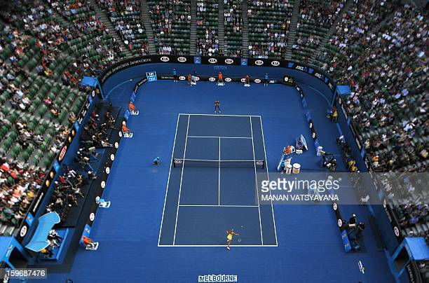 In this picture taken with a tilt and shift lens Russia's Maria Sharapova hits a return against Venus Williams of the US during their women's singles...