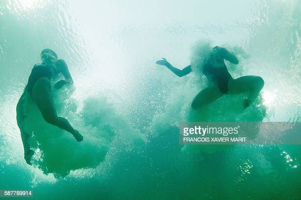 TOPSHOT In this picture taken with an underwater camera Malaysia's duet Jun Hoong Cheong and Pandelela Rinong Pamg compete in the Women's...