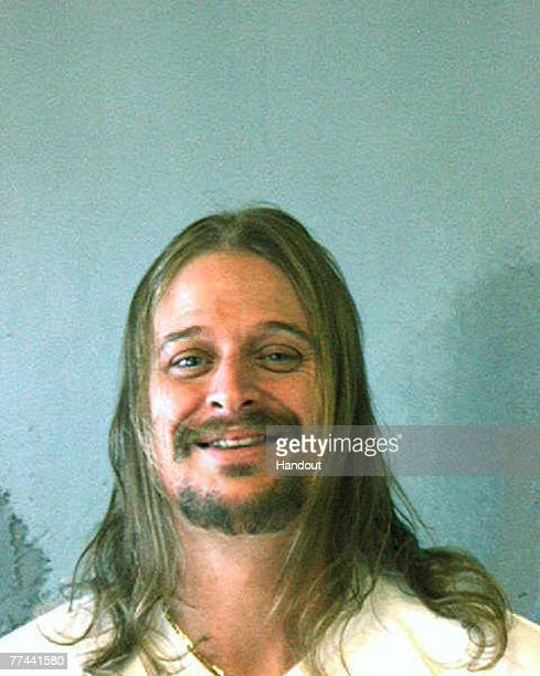 In this police mug shot from the DeKalb County Sheriff's Office musician Kid Rock or Robert J Ritchie poses for a mug shot October 21 2007 in DeKalb...