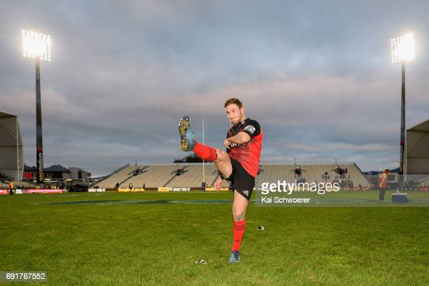 In this posed shot Mitchell Hunt of the Crusaders pretends to be kicking from the spot where he kicked the last minute winning drop goal during the...