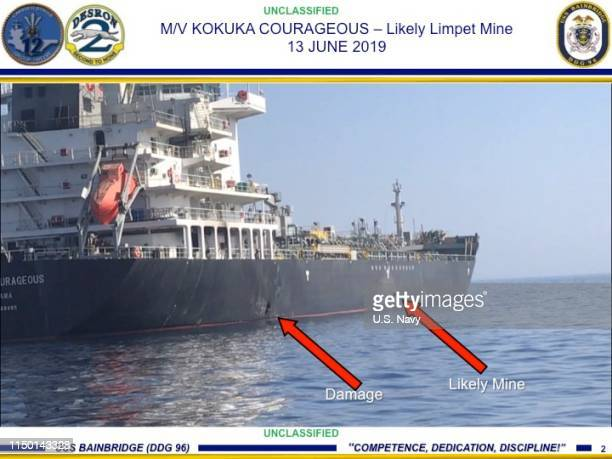 In this Powerpoint slide provided by US Central Command damage from an explosion left and a likely limpet mine can be seen on the hull of the...