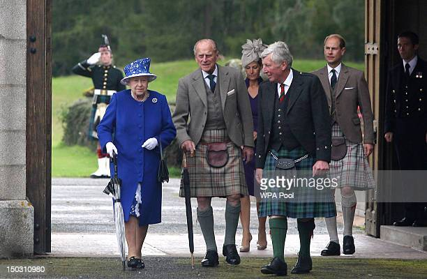 In this previously unissued file photo dated August 07 Queen Elizabeth II and Prince Edward, Earl of Wessex walk with Prince Philip, Duke of...