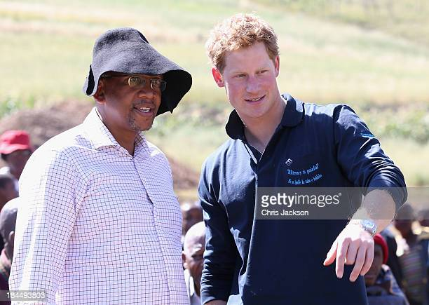 In this previously unreleased photo Prince Harry talks to Prince Seeiso of Lesotho as he helps lay the foundations for the new Sentebale Mateanong...