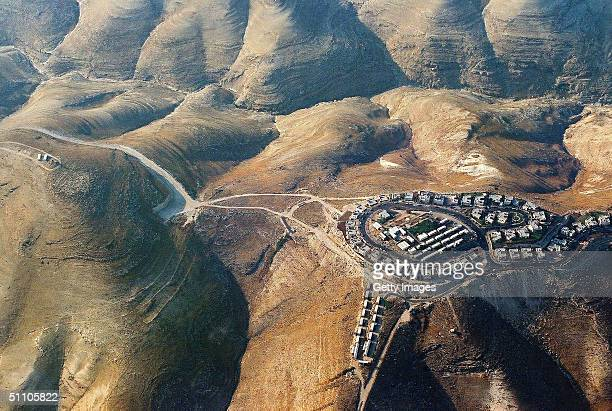 In this recent handout aerial photo from the leftwing Israeli movement Peace Now released on July 22 2004 the small illegal settler outpost of Givat...