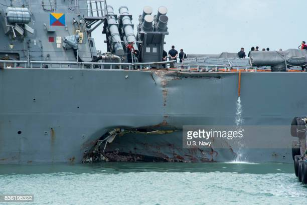 In this released US Navy handout damage to the portside is visible as the Guidedmissile destroyer USS John S McCain steers towards Changi Naval Base...