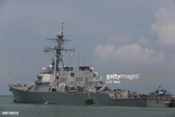 In this released US Navy handout guidedmissile destroyer USS John S McCain moored pier side at Changi Naval Base Republic of Singapore following a...