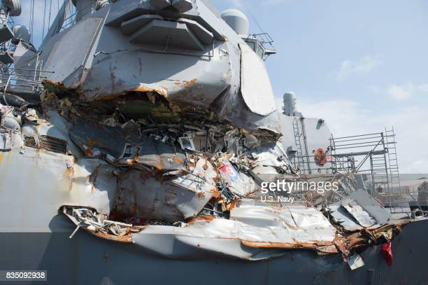 In this released US Navy handout The Arleigh Burkeclass guidedmissile destroyer USS Fitzgerald sits in Dry Dock 4 at Fleet Activities Yokosuka to...