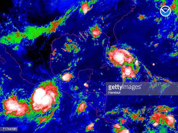 In this satellite colorized infrared image provided by the National Oceanic and Atmospheric Administration Tropical Storm Ernesto is shown at 100 pm...