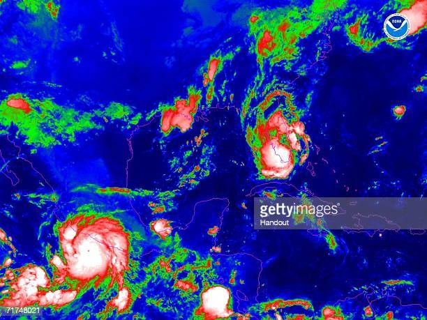 In this satellite colorized infrared image provided by the National Oceanic and Atmospheric Administration Tropical Storm Ernesto is shown at 800 am...