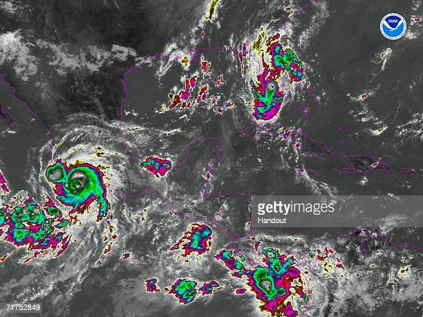 In this satellite colorized infrared image provided by the National Oceanic and Atmospheric Administration Tropical Storm Ernesto is shown at 1100 am...