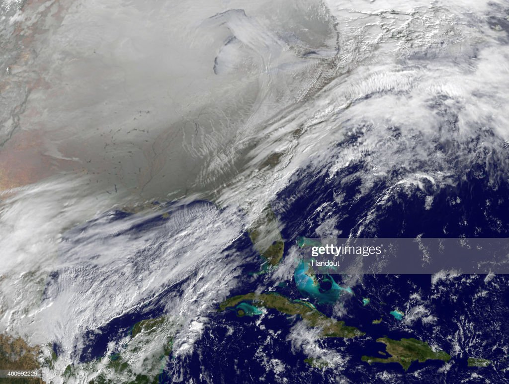 In this satellite handout image provided by National Oceanic and Atmospheric Administration (NOAA), shows the entry of a large area of low pressure, from the Polar Vortex, into the Northern U.S. January 6, 2014. The weather system is bringing dangerously cold temperatures not seen in half of the continental United States in about 20 years. It is expected to move northward back over Canada toward the end of the week.