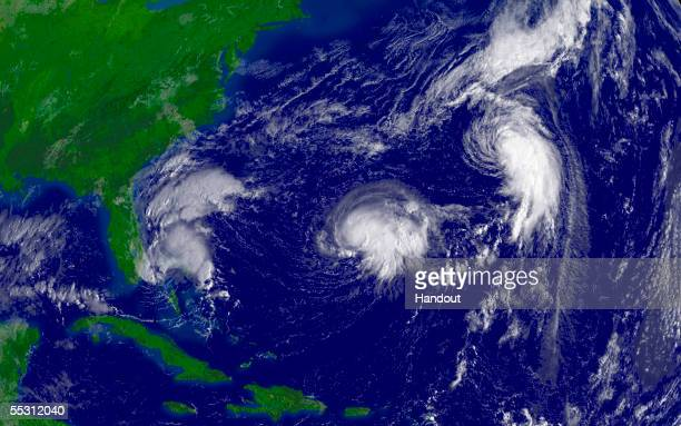 In this satellite illustration from NOAA Tropical Depression Sixteen is shown off the coast of Florida along with Tropical Storm Nate and Hurricane...