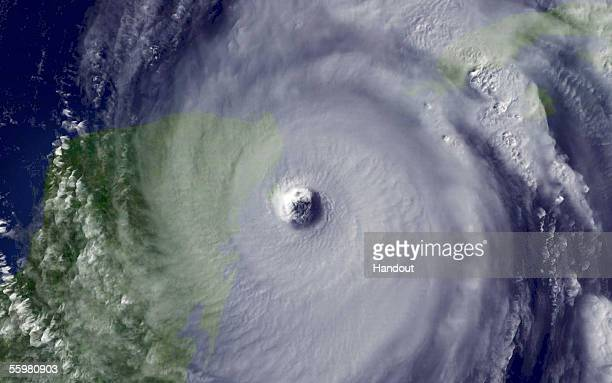 In this satellite image from NOAA taken at 1015 am EDT Hurricane Wilma lashes the Yucatan penisula October 21 2005 Wilma now a Category 4 storm is...
