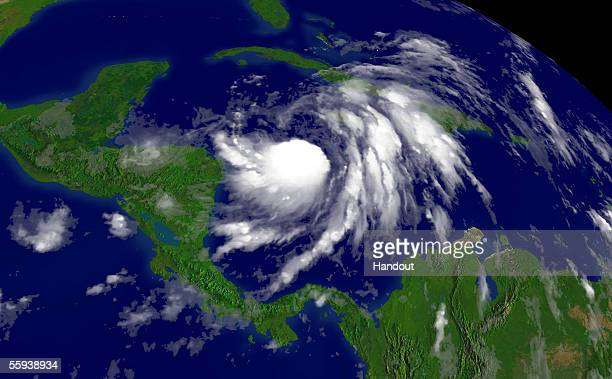 In this satellite image from NOAA taken at 915 am EDT Tropical Storm Wilma is seen located southeast of Grand Cayman and moving southward at 5 MPH on...