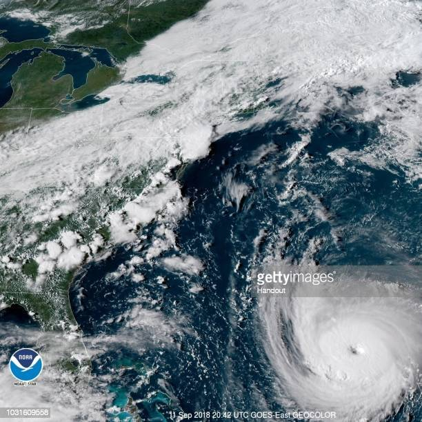 In this satellite image provided by National Oceanic and Atmospheric Administration Hurricane Florence churns through the Atlantic Ocean toward the...