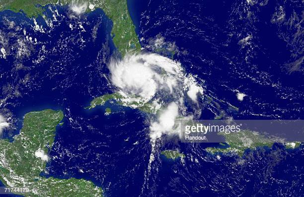 In this satellite image provided by the National Oceanic and Atmospheric Administration Tropical Storm Ernesto is shown at 1215 pm EDT moving over...