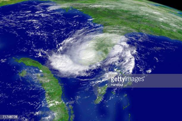 In this satellite image provided by the National Oceanic and Atmospheric Administration Tropical Storm Ernesto is shown at 1015am EDT over southern...