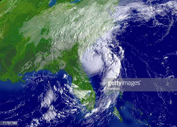 In this satellite image provided by the National Oceanic and Atmospheric Administration Tropical Storm Ernesto is shown at 815 am EDT is shown...
