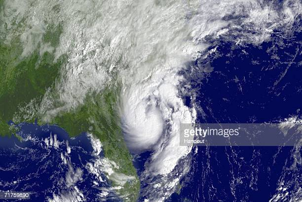 In this satellite image provided by the National Oceanic and Atmospheric Administration Tropical Storm Ernesto is shown at 945 am EDT is shown...