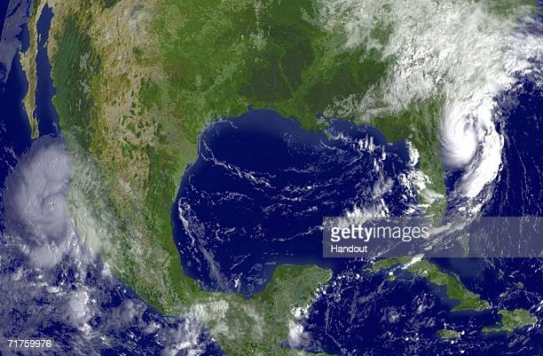 In this satellite image provided by the National Oceanic and Atmospheric Administration Tropical Storm Ernesto is shown at 945 am EDT is shown east...