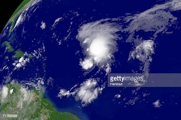 In this satellite image provided by the National Oceanic and Atmospheric Administration Tropical Storm Florence is shown at 645 am EDT is shown...