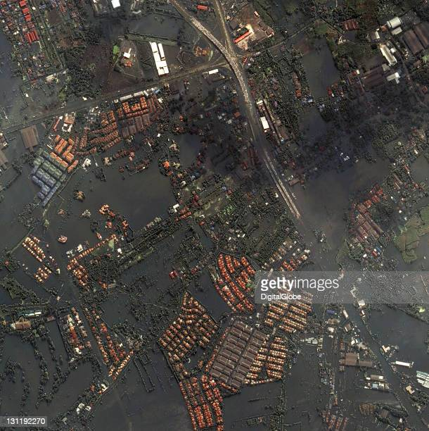 In this satellite view a stretch of highway shows cars parked to avoid floodwaters on October 24 2011 in Bangkok Thailand Thailand is experiencing...