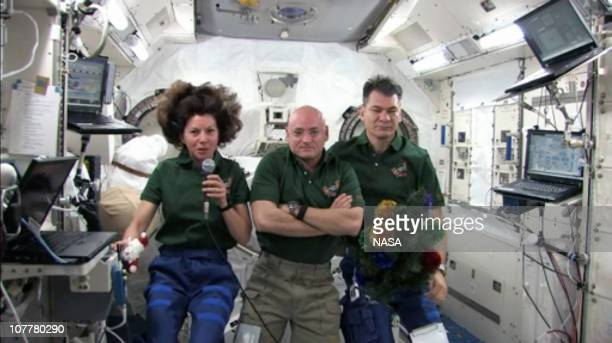 In this screen capture image provided by NASA, Flight Engineer Catherine Coleman, Commander Scott Kelly, and Flight Engineer Paolo Nespoli, memebers...
