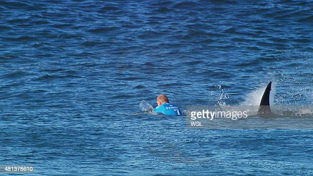 In this screen grab from footage by the World Surf League Mick Fanning of Australia being attacked by a Shark at the Jbay Open on July 19 2015 in...
