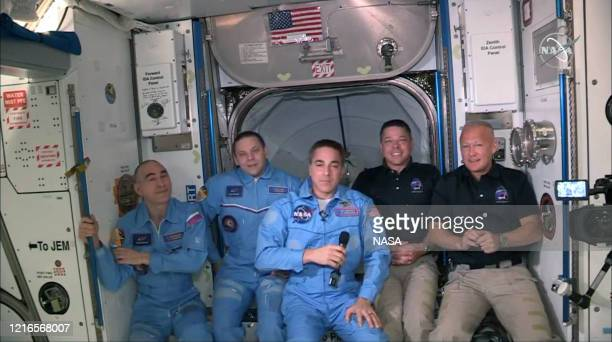 In this screen grab from NASA's feed, NASA astronauts Doug Hurley and Bob Behnken join NASA astronaut Chris Cassidy and Russian cosmonauts, Anatoly...