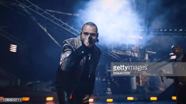 In this screen grab released on October 16th 2020, Post Malone and Tyla Yaweh perform at the 2020 Billboard Music Awards, broadcast on October 14th,...