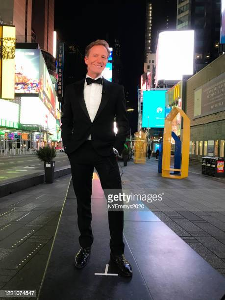 In this screengrab A N J Burkett poses in Times Square during a livestream for the 63rd Annual Emmy Awards on April 25 2020 in New York NY United...