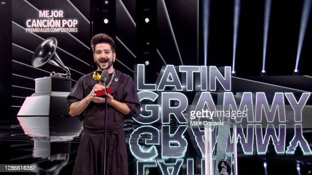 In this screengrab, Camilo accepts the Best Pop Song award for 'Tutu' during The 21st Annual Latin GRAMMY Awards at American Airlines Arena on...